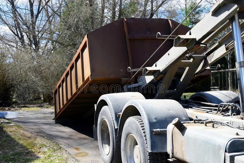 Truck roll-off dumpster. Horizontal image stock photography