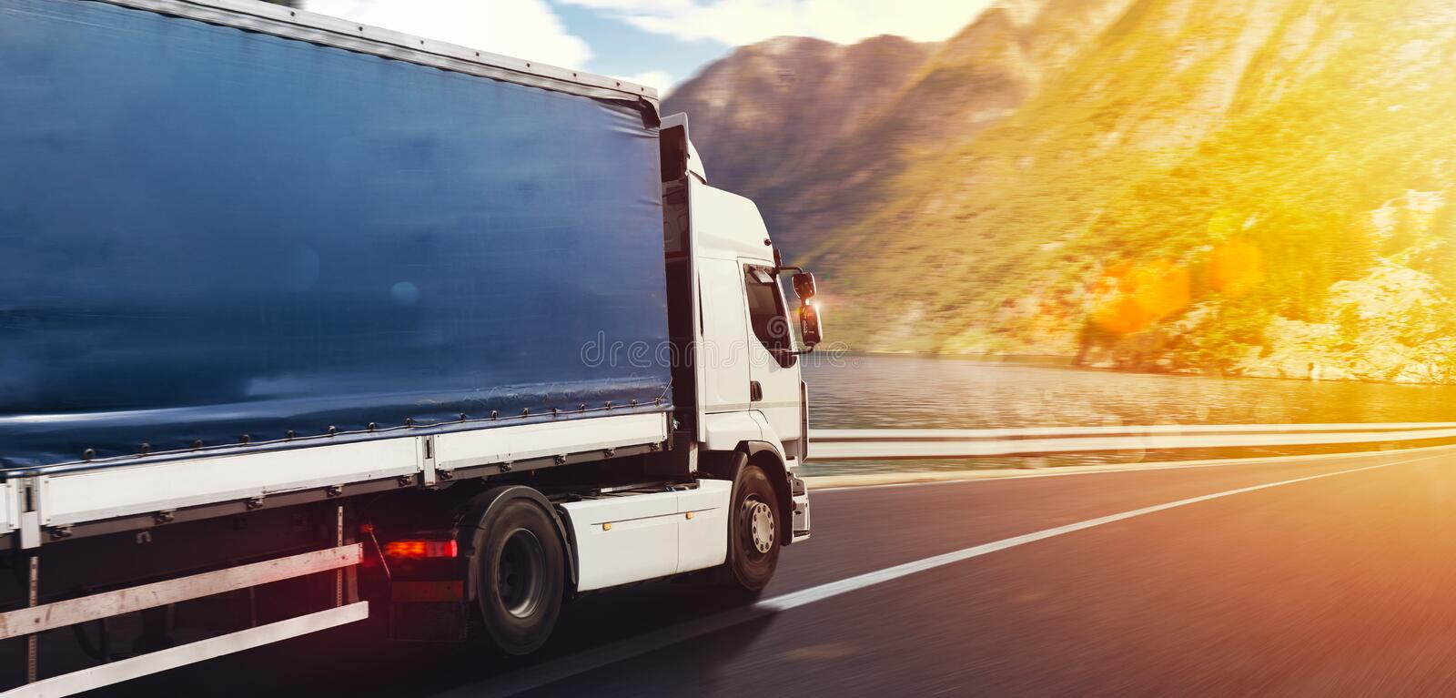Truck run fast on the highway to deliver royalty free stock photography