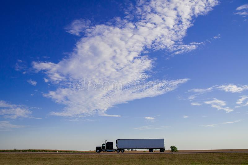 Truck is running on the freeway of the country side in America. America is a continent where American mainly live. royalty free stock photography