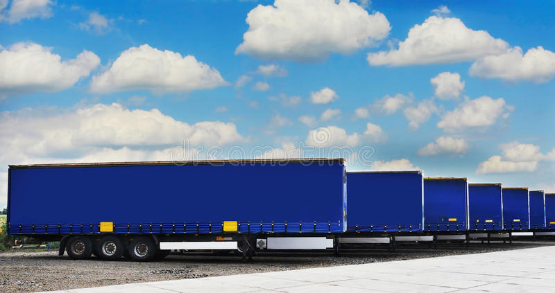 Truck semi trailers waiting. To be unloaded at a warehouse or factory royalty free stock images