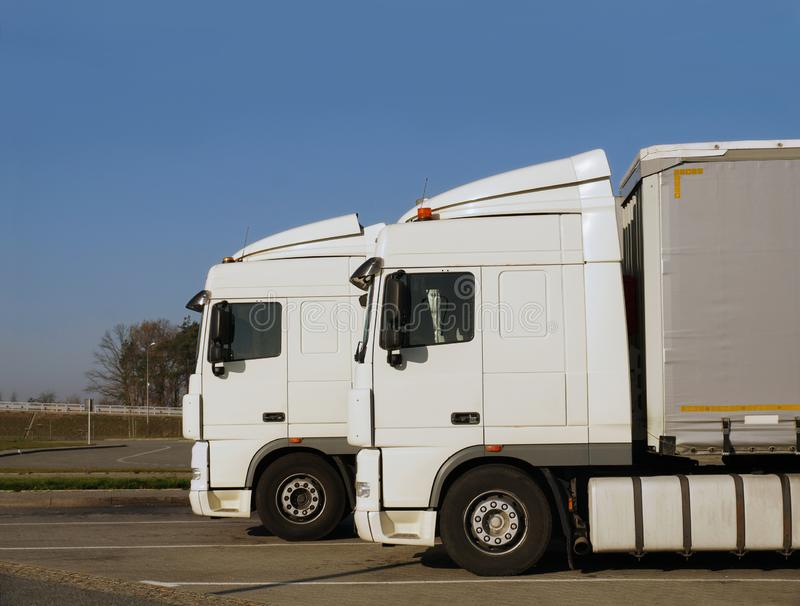 Truck service center. Two of the same trucks parked on the parking square. stock photography