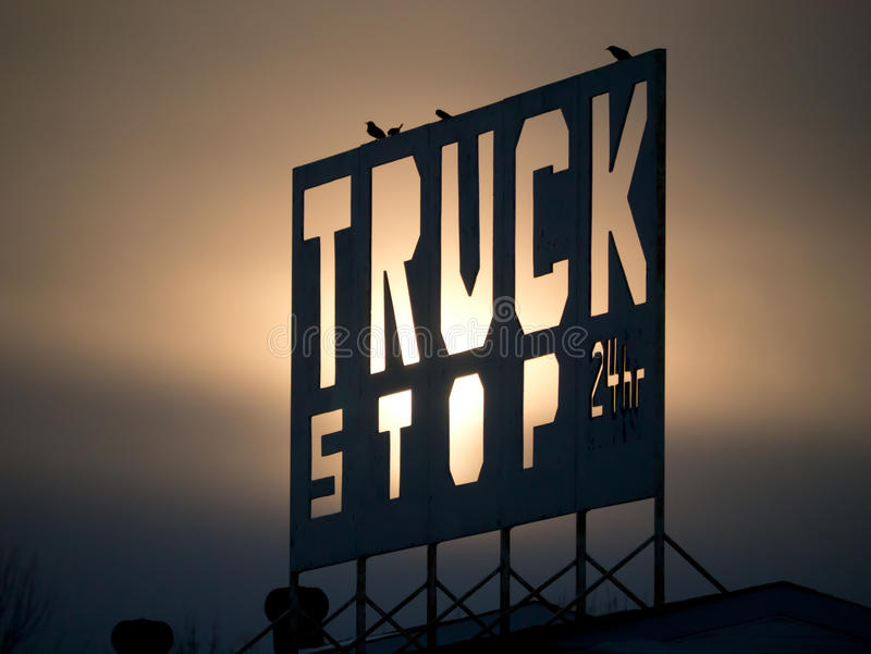 Truck Stop Sign. Early evening shot of a truck stop sign before the slowly setting sun royalty free stock photography