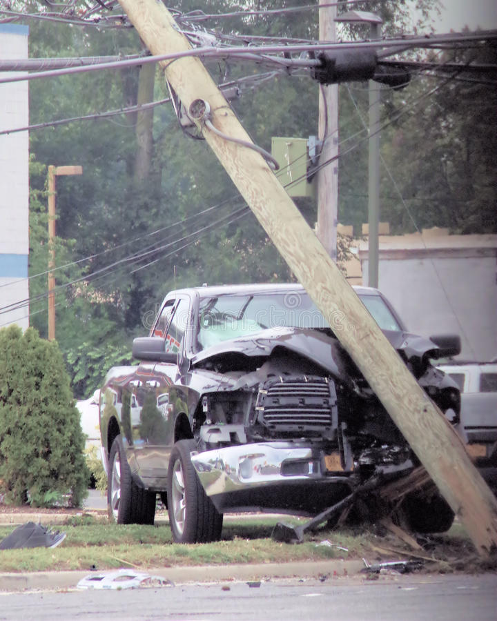 Truck takes out power pole in Bethpage NY. September 29,2014 approx 12:00 noon a truck hit a power pole in Bethpage NY on Hempstead Turnpike. Traffic lights were stock photography