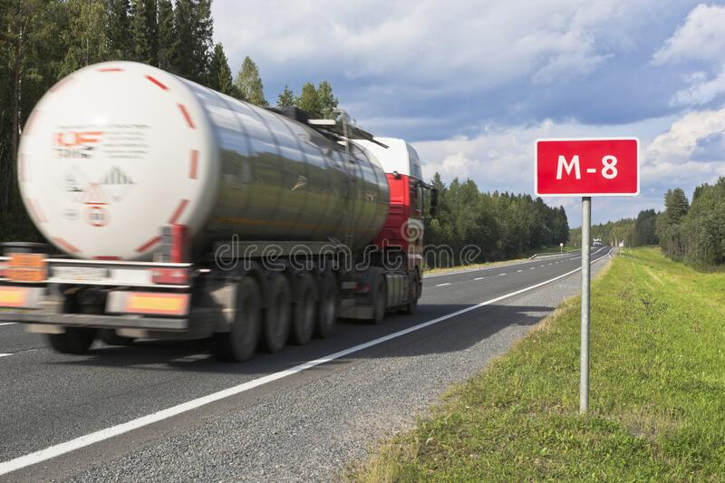 A truck with a tank driving on the M8 road in the Vologda region royalty free stock photos