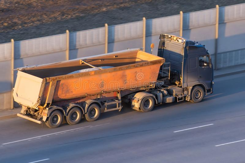 Truck with a trailer for bulk driving on the highway.  royalty free stock photos