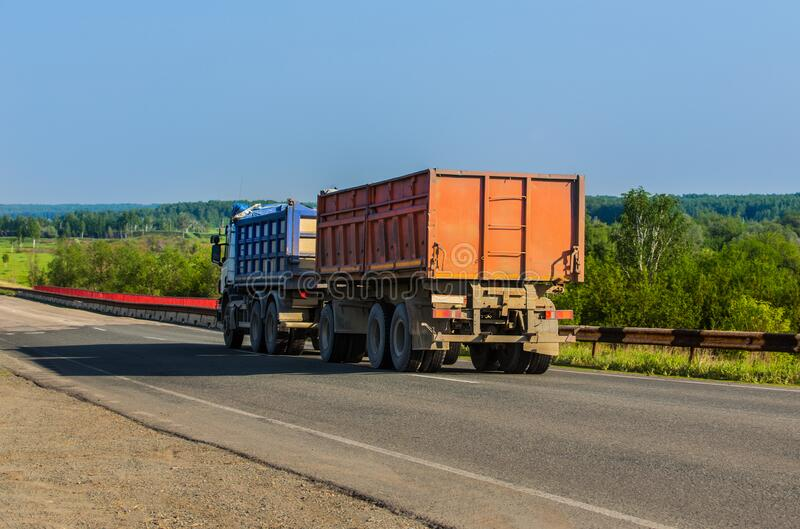 Truck with a Trailer Carries Goods. On a country road royalty free stock photos