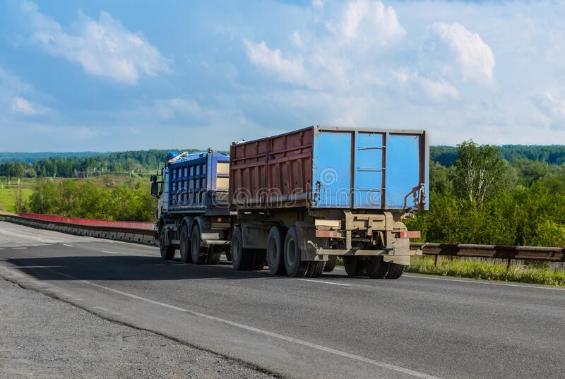 Truck with a Trailer Carries Goods. On a country road stock image