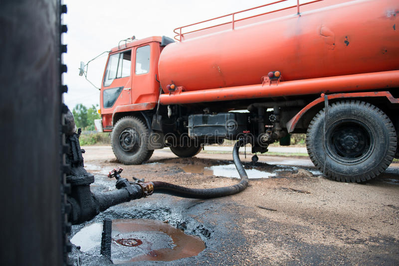 Truck transfer crude oil from the tank royalty free stock photo