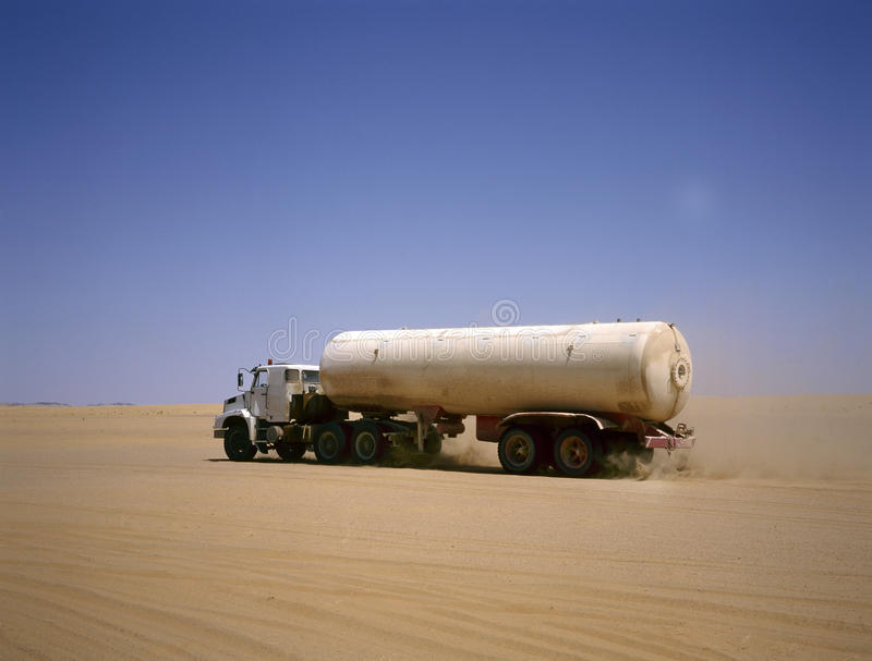 Truck driving through the Arab desert royalty free stock images