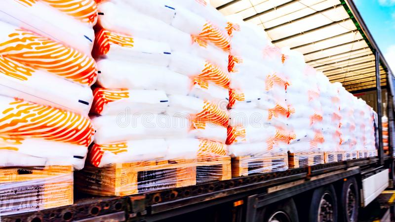 Truck in unloading in warehouse . There is a loading to the truck trailer . Concept of wholesale . fastening of freight in the trailer . distribution warehouse royalty free stock photo