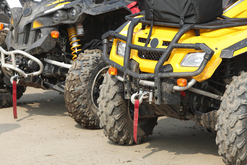 Trucks. Low angle veiw of the front part of a row of ATVs royalty free stock photography