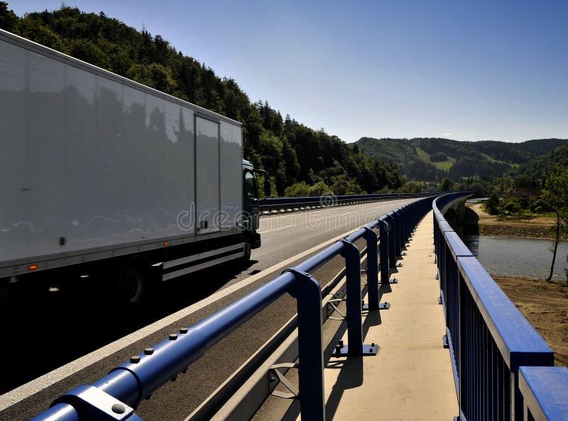 Trucks on a bridge