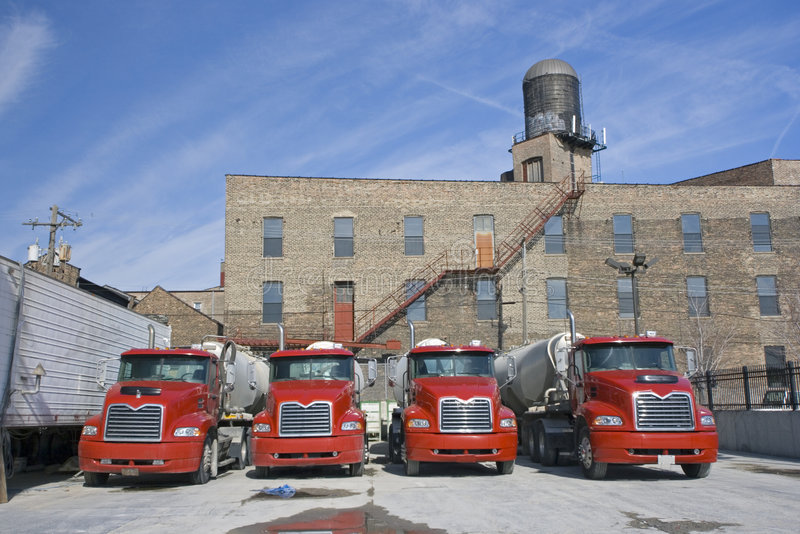 Trucks in concrete factory royalty free stock image