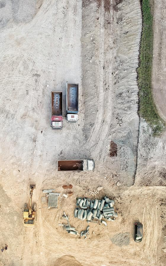 Trucks on a construction site seen from drone royalty free stock images