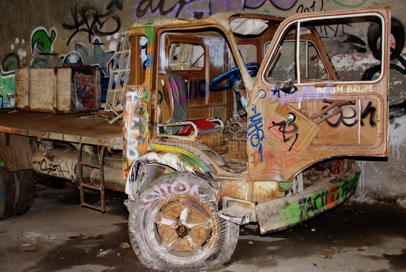 Trucks decorated with spray cans rave party. HDR shot of decorated trucks to spray gun , in the city of Consonno during a rave party royalty free stock photos