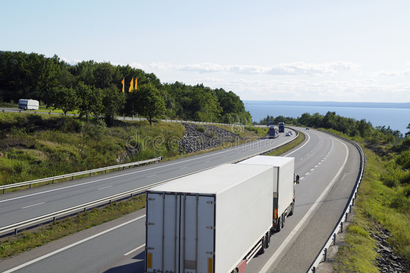 Trucks driving through mountain pass royalty free stock photos