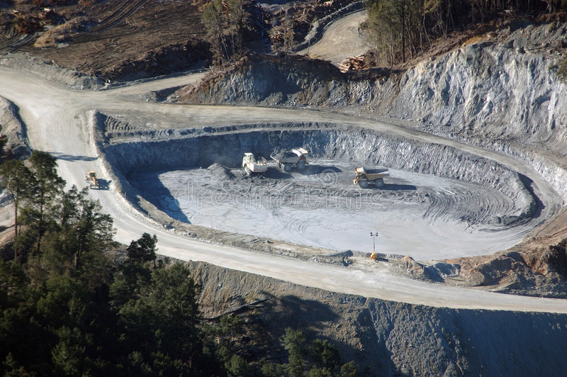 Trucks at gold mine. Aerial of trucks working at gold mine, Westland, New Zealand stock photos