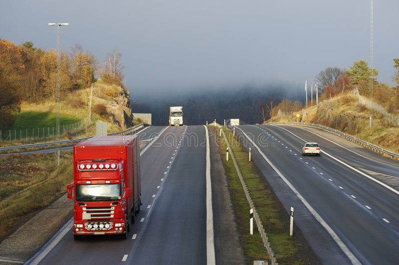 Trucks, highway and mist stock images