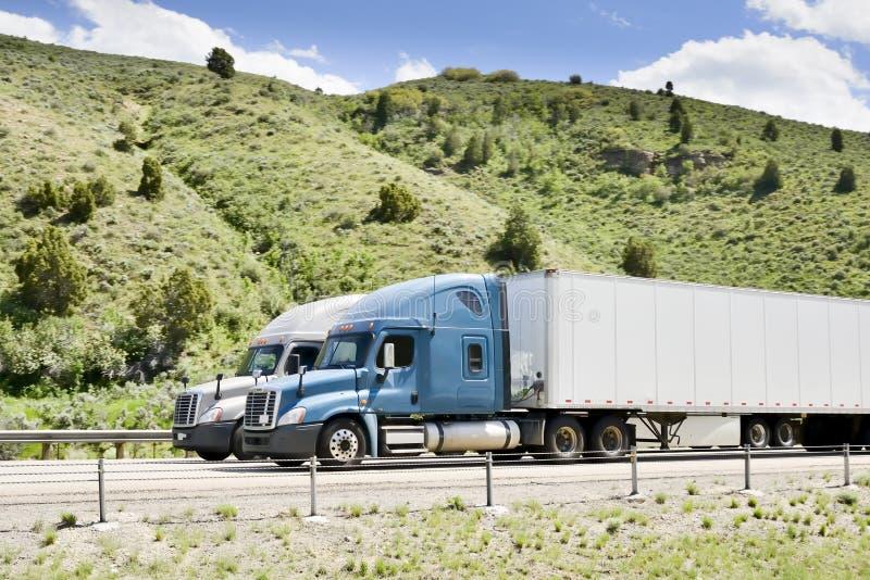 Trucks on interstate. stock photos