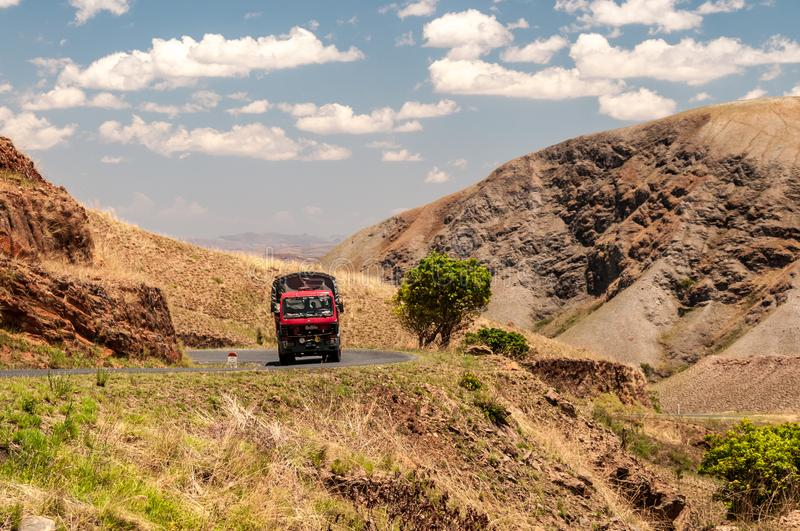 Trucks on a Malagasy highland road stock photography