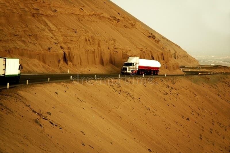 Trucks on mountainside road royalty free stock image