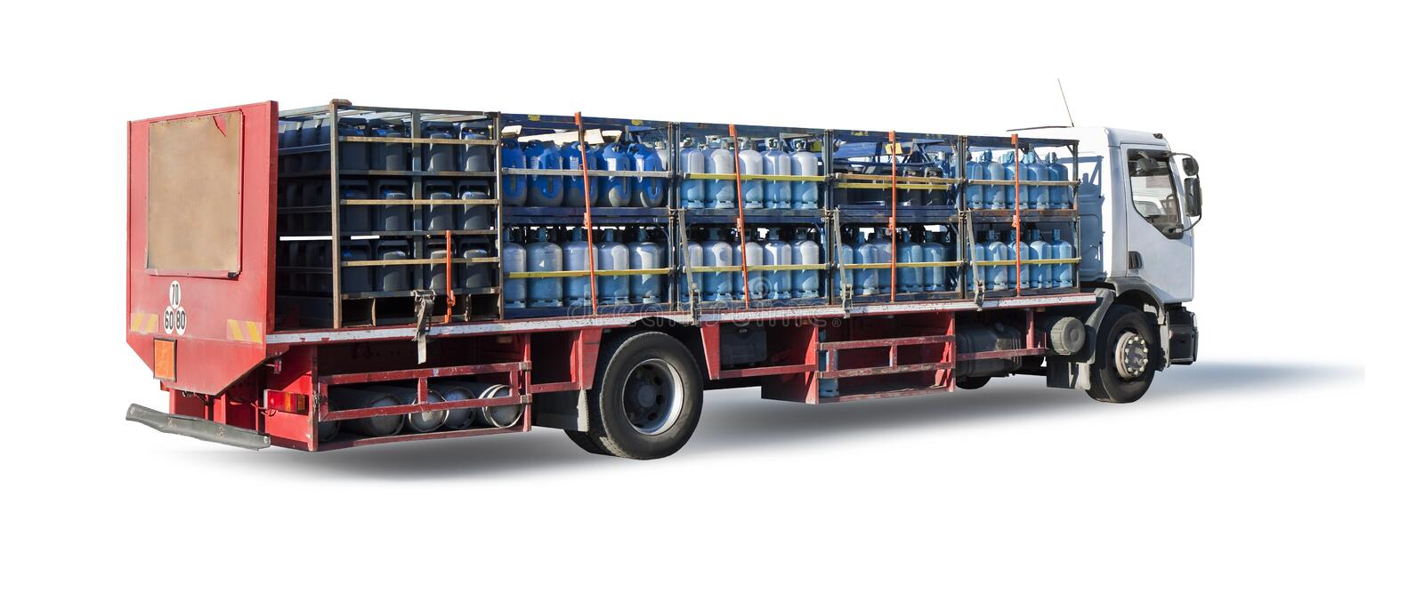 Trucks parked with many colored propane gas tanks on white background for easy selection.  royalty free stock image