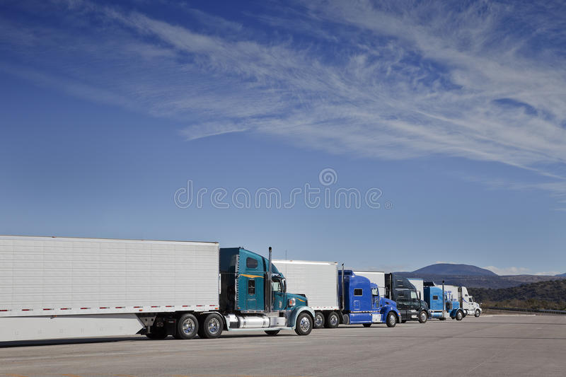 Trucks are parking at the Rest Area. Trucks are parking on a row while the drivers taking a break at the Rest Area stock photo