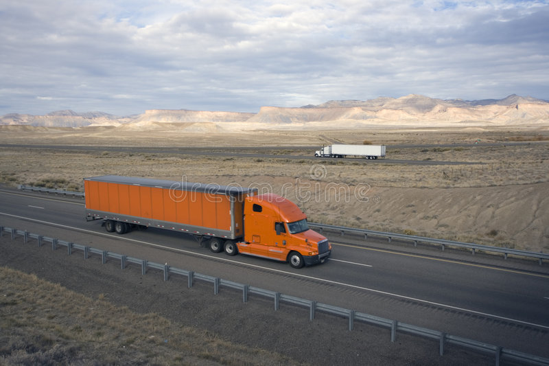 Trucks on the road stock photography