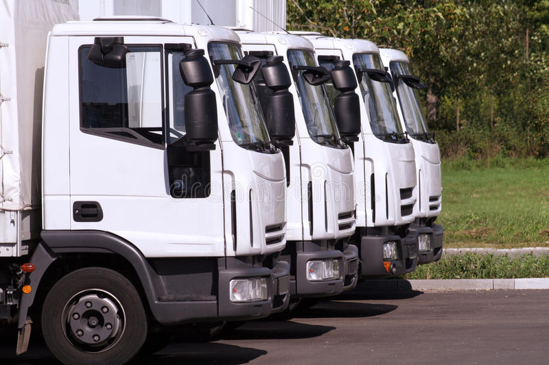 Trucks in row. Four trucks of a transporting company in a row royalty free stock photography
