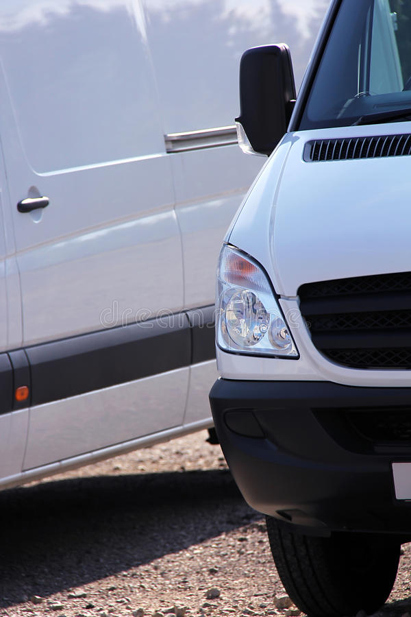 Trucks in a row. White delivery cars are waiting for some work royalty free stock photos