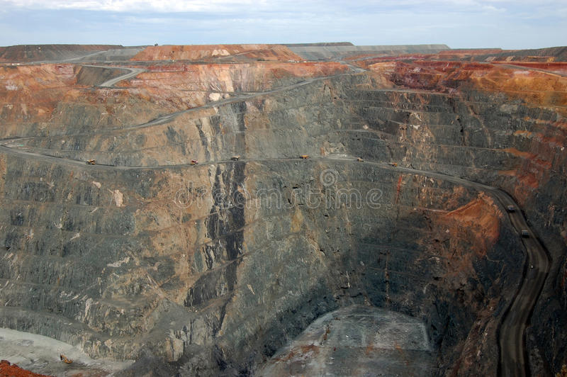 Trucks in Super Pit gold mine Australia royalty free stock images