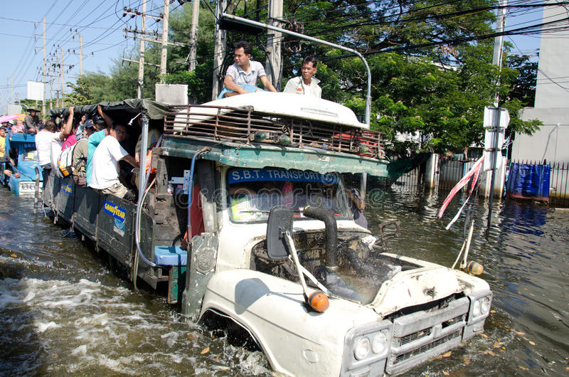 Trucks to the refugees from the area flooded. BANGKOK THAILAND – NOVEMBER 13: Truck carries a group of people to evacuate from the flooded area at Phahon stock image