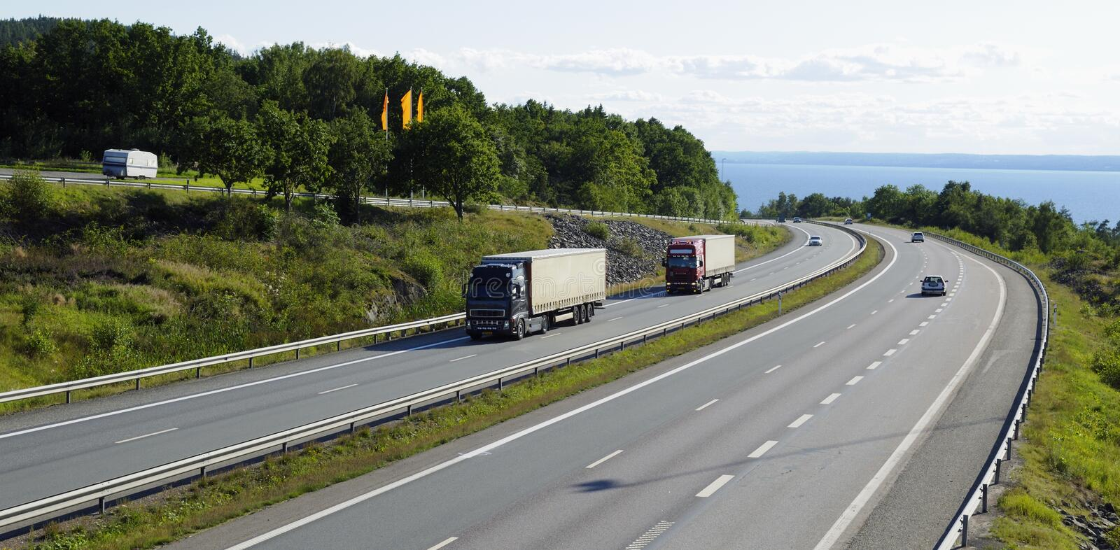 Trucks and traffic, panoramic view royalty free stock photography