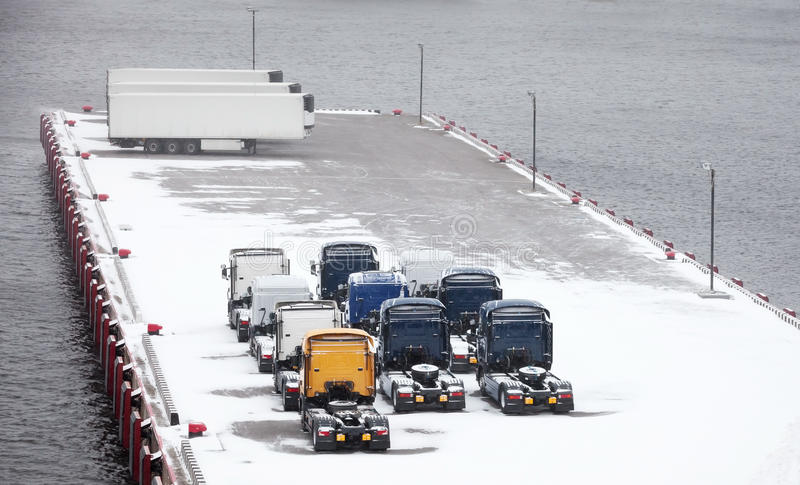 Download Trucks And Trailers Waits On Snowbound Pier Stock Image - Image: 28221873