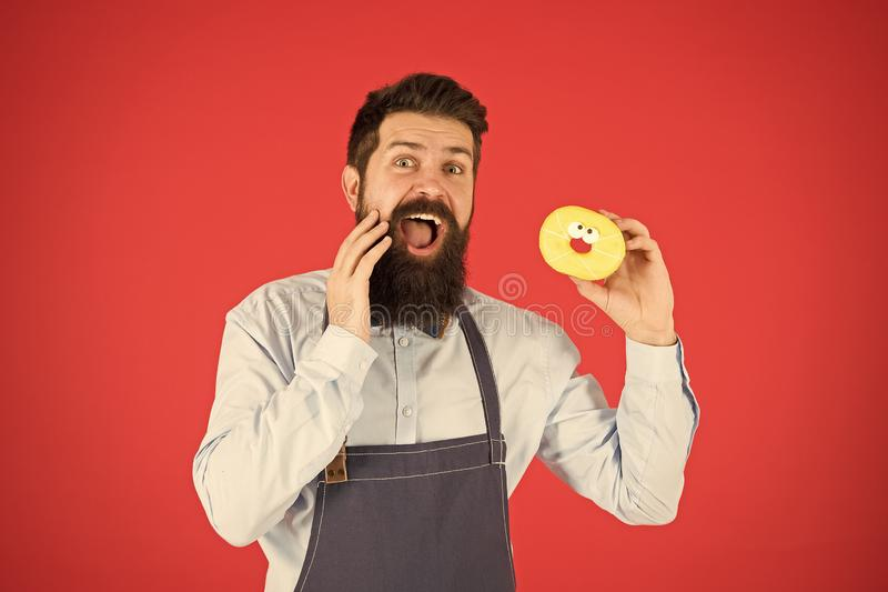 True facts about sugar. No way. Hipster bearded baker hold glazed donut on red background. Cafe and bakery concept. Sweet donut from baker. Man bearded baker royalty free stock photo