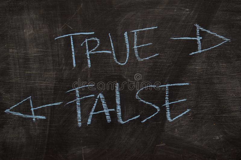 True or False written with color chalk concept on the blackboard stock image