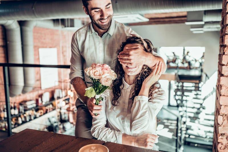 True feelings. Beautiful romantic couple in cafe. stock photos