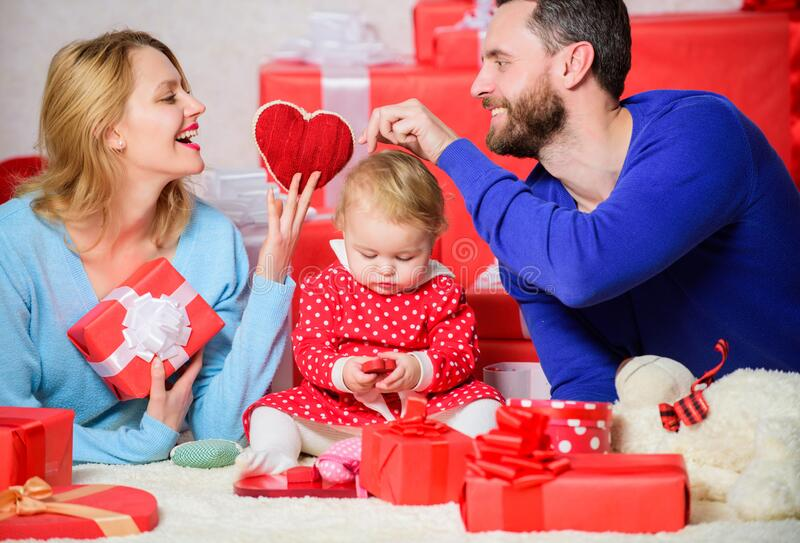 True happiness. father, mother and doughter child. Shopping online. Boxing day. Valentines day. Red boxes. Happy family stock photography
