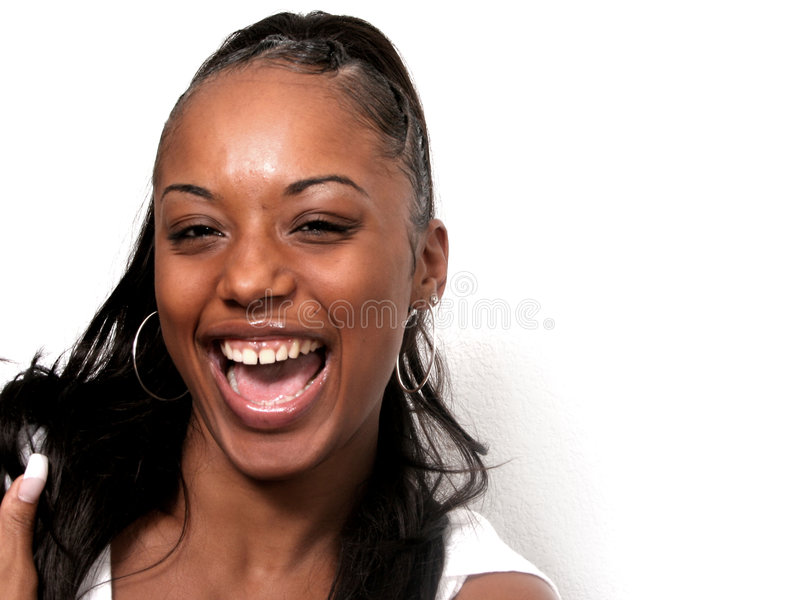 True Laughter. Beautiful African American woman laughing out loud