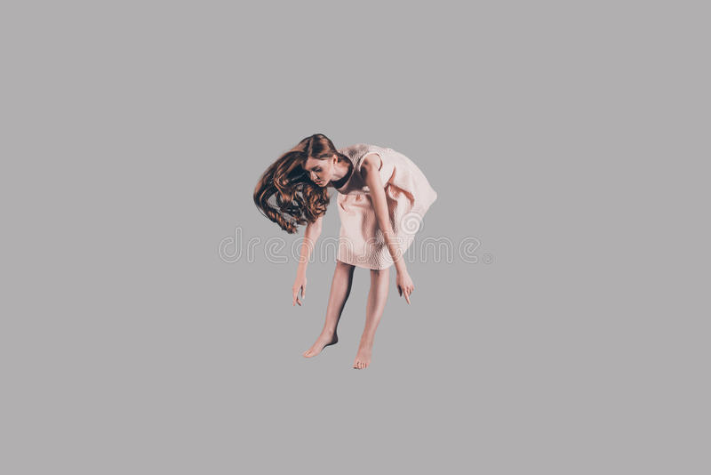 True levitation. Studio shot of attractive young woman hovering in air royalty free stock images