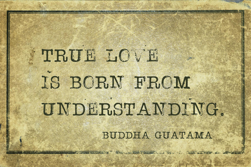 True love Buddha. True love is born from understanding - famous Buddha quote printed on grunge vintage cardboard royalty free stock photos