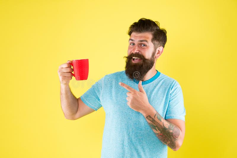 True specialty coffee is becoming big business. Energy concept. Hipster barista yellow background. Coffee shop. Bearded stock photo