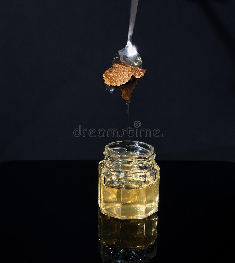 Free Truffle Mushroom In A Jar Of Honey On A Black Background. Minimalism In Composition. Luxury Food. Free Space For Text Royalty Free Stock Image - 136989306