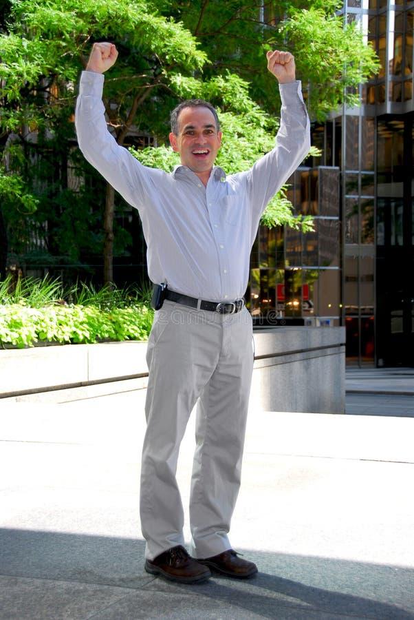 Truimph do homem de negócios foto de stock