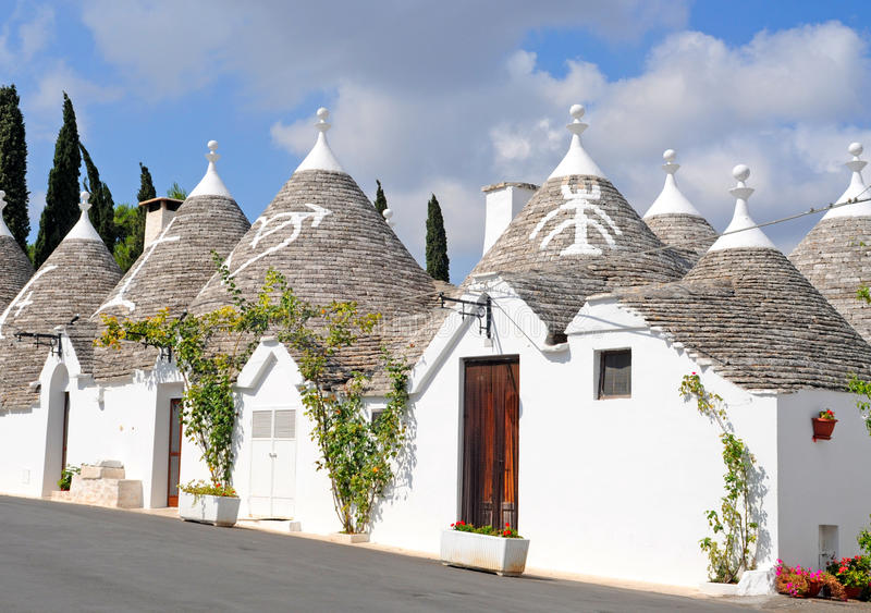 Trulli houses in Alberobello, Italy. Trulli houses with painted symbols on the conical roofs in Alberobello, Italy, Puglia royalty free stock image