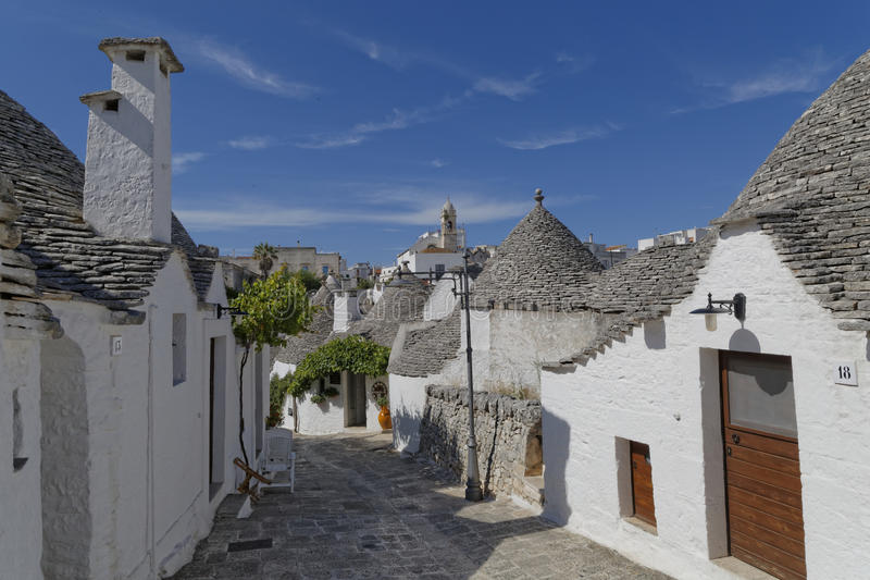 Trulli houses. Image of of trulli houses with church in the background taken in Alberobello. Apulia stock photo