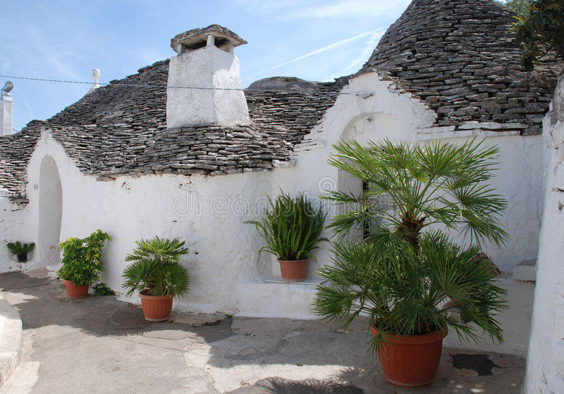 Trulli Houses with Plants. Traditional trulli houses in Alberobello in Puglia, southern Italy. The trulli, which are protected under UNESCO World Heritage laws royalty free stock photo