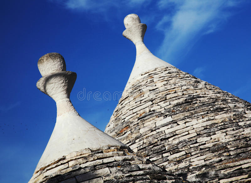 Trulli roof and blue sky. Detail of trulli in alberobello famous italian village royalty free stock photos