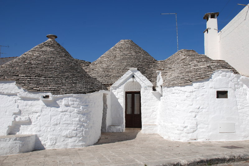 Trullo. A traditional trullo house in Alberobello in Puglia, southern Italy. The trulli, which are protected under UNESCO World Heritage laws, are traditional stock photos