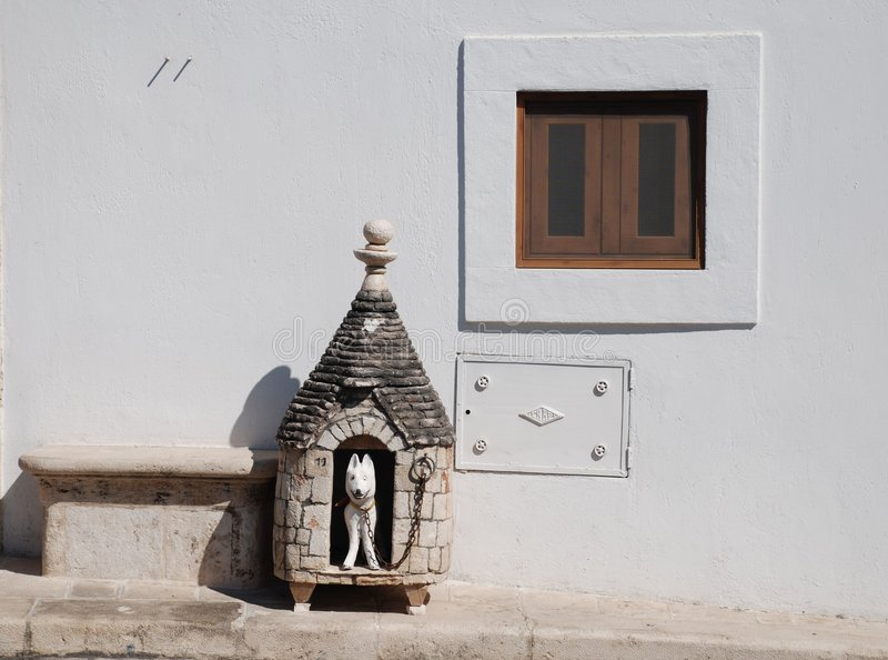 Trullo Dog Hut. A pretend dog hut outside a traditional trulli houses in Alberobello in Puglia, southern Italy. The trulli, which are protected under UNESCO stock photos